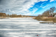 Winter lake. Dark clouds over a frozen lakewith stock image