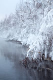 Winter lake with fog over the water Stock Photo