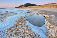 Winter, Lake Michigan Shoreline. Iced shoreline of Lake Michigan near sunset, Saugatuck Dunes State Park, Michigan, USA Royalty Free Stock Photo