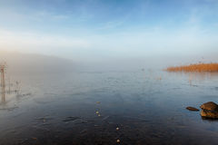 Winter lake in mist. A frozen lake a misty winter morning stock images