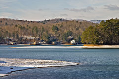 Winter Lake and Mountain Scene. Snow and ice around the lake in the winter and on some distant mountains.  Lake Burton in north Georgia Stock Images