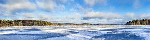 Winter lake panorama Finland. Panoramic view over frozen lake in Finland in February 2017 Royalty Free Stock Images