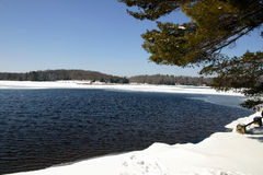 Winter Lake Scene. Wilderness winter in the Pocono Mountains of Pennsylvania, USA.  Promised Land State Park Royalty Free Stock Images
