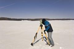 Winter land surveying Stock Images