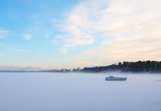Winter landscape. With frozen lake and boat on it Stock Photo