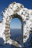 Winter landscape. Frozen window of ruin above the clouds at mountain Stock Photography