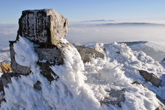 Winter landscape. Frozen rock above the clouds at mountain Royalty Free Stock Photos