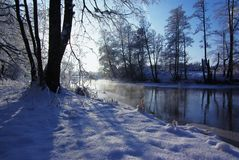 Winter landscape. Beautiful winter landscape of  forest river, clear, frosty weather, vapor upon the water Royalty Free Stock Images