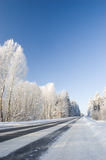 Winter landscape. Winter road with deep blue sky and frozen trees Royalty Free Stock Photos