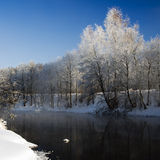 Winter landscape. With unfrozen river in white snow Stock Photography