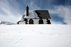 Winter landscape. Isolated cottage in snow covered landscape Royalty Free Stock Image