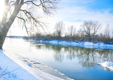 Winter landscape. With the river in sunny day stock photos