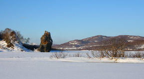 Winter landscape. Sunny winter landscape of Kamchatka with Ninkin stone Royalty Free Stock Images