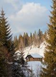 Winter landscape. Winter hut in mountain landscape Royalty Free Stock Photos