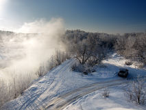 Winter landscape. View from the top to the winter forest and river Stock Images