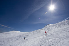Winter landscape. Sunrise on Jahorina mountain, near Sarajevo, Bosnia, with a skier allready on track Royalty Free Stock Photography