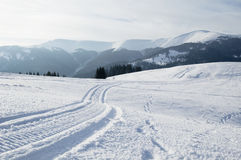 Winter landscape. Winter snowing landscape with mountains on horizon stock images