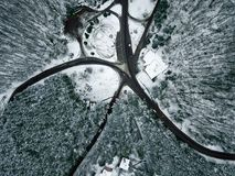 Winter landscape. Aerial view snowy forest and road Stock Photos