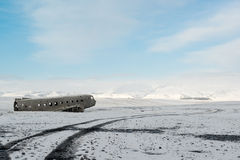 Winter landscape with airplane wreckage and snow capped mountains, Iceland Stock Photo