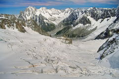 Winter landscape in Alps Mountains. Sun and snow in Valley Blanche, landmark attraction in France Stock Image