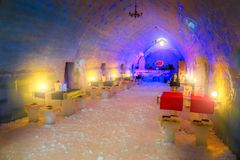 Spectacular ice hotel and bar on the frozen Balea lake. Winter landscape, Amazing famous ice hotel and bar with equipment on the frozen Balea lake in Fagaras royalty free stock photos