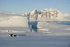 Winter landscape of Antarctica. Winter landscape of the old station on the background of the Antarctic Peninsula Stock Photos