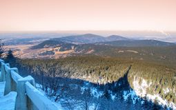 Winter landscape around Jested with mountain and TV transmitter shadow silhouette, Czech Republic.  Royalty Free Stock Photography