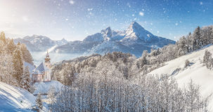 Winter landscape in the Bavarian Alps with church, Bavaria, Germany. Panoramic view of beautiful winter landscape in the Alps with pilgrimage church Maria Gern Stock Photo