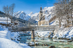 Winter landscape in the Bavarian Alps with church, Ramsau, Germany Stock Photos