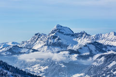 Winter Landscape. Beautiful winter landscape in the Mont Blanc Massif with the view to the Chaine des Aravis above the clouds Royalty Free Stock Photos