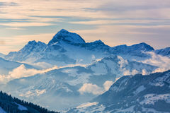 Winter Landscape. Beautiful winter landscape in the Mont Blanc Massif with the view to the Chaine des Aravis above the clouds and villages Royalty Free Stock Photography