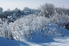 Winter landscape with beautiful white trees and house Santa Klaus Stock Photo