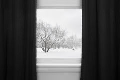 Winter landscape behind black curtains Royalty Free Stock Photos