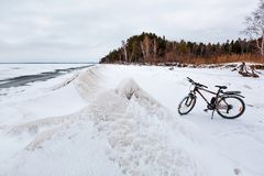 Winter landscape with a Bicycle on the frozen river. The Ob Rive Stock Images