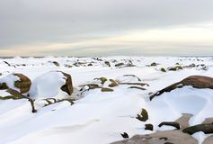 Winter landscape with big stones. Beautiful winter sunset over the Baltic Sea in Latvia. -15, ice and cold is everywhere. Big stones covered with snow stock photos