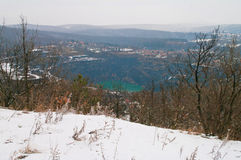Winter landscape with blue lake Royalty Free Stock Photography