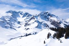 Winter landscape with blue sky in austria by drone stock photo