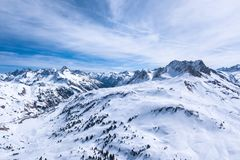 Winter landscape with blue sky in austria by drone royalty free stock photos