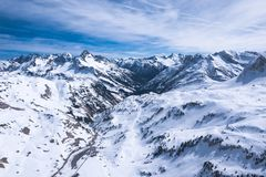 Winter landscape with blue sky in austria by drone stock image