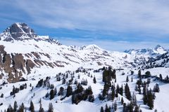 Winter landscape with blue sky in austria by droneberg stock images