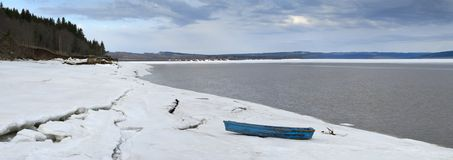 Winter Landscape with boat Stock Images