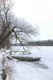 Winter landscape with a boat. Stock Images