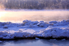 Winter landscape. Breathing of the river. stock images