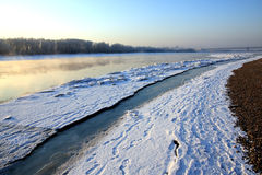 Winter landscape. Breathing of the river. stock photos