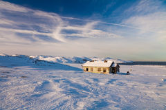 Winter landscape with cabin hut Stock Photos