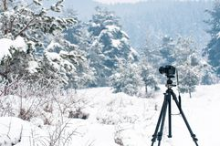 Winter landscape, camera on tripod in focus. Big snow, cold weather Stock Photo