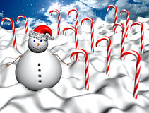 Winter landscape with candy canes and snowman. Snow and real sky on the background Royalty Free Stock Photo