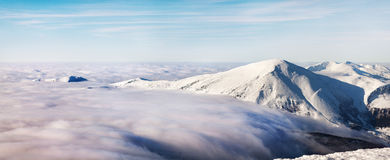 Winter landscape of the Carpathian Mountains in Ukraine. The top is tight fog and obscured by clouds Stock Photo