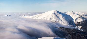 Winter landscape of the Carpathian Mountains in Ukraine. The top is tight fog and obscured by clouds Stock Images