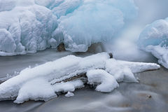 Winter, Gull Creek Cascade. Winter landscape of cascade captured with motion blur and framed by blue ice, Gull Creek, Michigan, USA Stock Photos